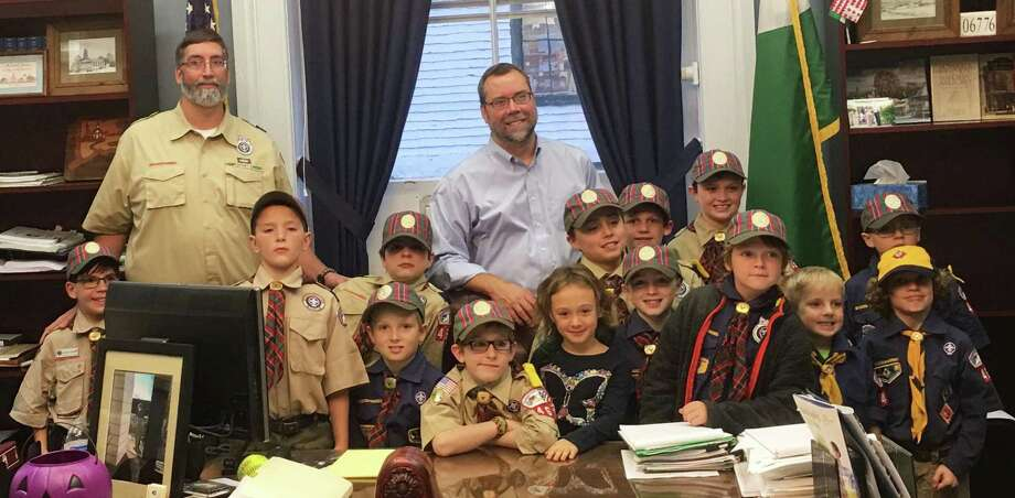 Members of New Milford Boy Scout Pack 467s Webelos den, along with some siblings and Cubmaster and den leader Matt Higgins, recently met with New Milford Mayor David Gronbach. They are, from left to right, in front, Jackson Higgins, Bill Kaschube, Michael Karaffa, Connor Rivera, Lilah Reguin, Jarrod St. Amand, Ian Reguin, Andrew Karaffa and Oliver Brandel, and in back, Cubmaster Matt Higgins, Declan OBrien, Mayor David Gronbach, Will Bergner, Carter Brandel, Talon Profeta and Aidan Atherton. Photo: Courtesy Of Jeannette St. Amand