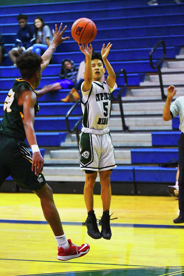 Cy Ridge senior guard Andre Tran puts up a shot from behind the arc Tuesday against Stratford. Though the Rams fell to the Spartans 102-78, Tran enjoyed a productive, effective day at the office, scoring 19 points and orchestrating the Cy Ridge offense. Photo: Tony Gaines / HCN