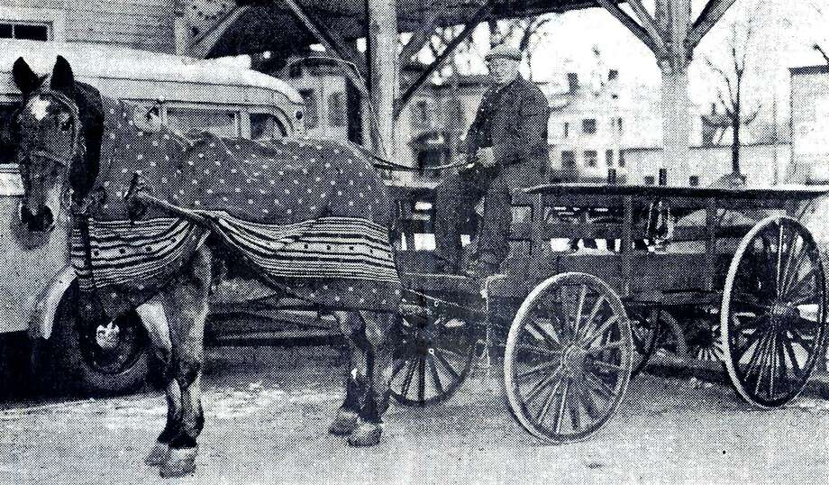Philip Rooney of New Milford and his horse, Major II, carrying mail sacks back and forth daily between the New Milford post office on Bridge Street and the New Milford (train) depot. Mr. Ronney, native of Ireland before coming to the United States at age 17, was the grandfather of the Hulton clan, including Helena Conn. Before moving to New Milford, Rooney lived in Roxbury where he farmed and worked in a hauling business with horse and cart. Photo: Contributed Photo / Contributed Photo / The News-Times Contributed