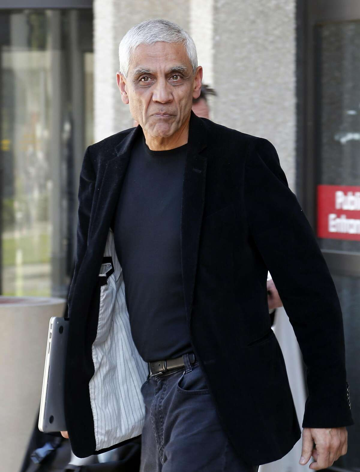 File - In this May 12, 2014, file photo, Sun Microsystems co-founder Vinod Khosla leaves San Mateo County Superior Courthouse after testifying in Redwood City, Calif.