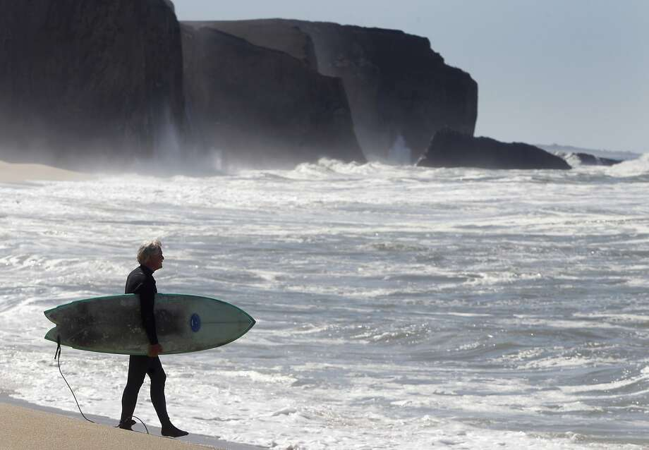 Mark Massara, one of the attorneys representing the Surfrider Foundation, is ready to surf at Martin's Beach in Half Moon Bay, Calif. on Thursday, Sept. 25, 2014, one day after a judge ordered landowner Vinod Khosla to unlock a private gate and allow public access to the beach. Photo: Paul Chinn, The Chronicle