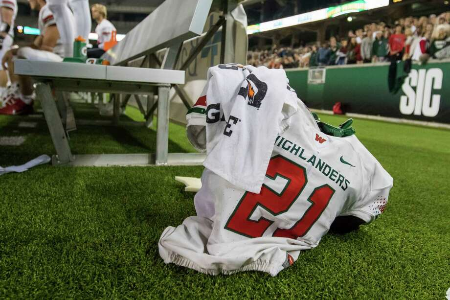 In this Nov. 26, 2016, photo, The Woodlands linebacker Grant Milton (21) is shown during a Class 6A Division I regional semifinal game in Waco, Texas. School officials say Milton is in intensive care after suffering an injury during a playoff game. Conroe Independent School District spokeswoman Sarah Blakelock said in a statement Monday that Grant Milton was injured during the regional football playoff game Saturday. (Jason Fochtman/Houston Chronicle via AP) Photo: Jason Fochtman, MBO / Houston Chronicle