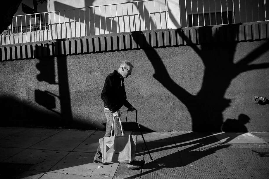Larry Williams walks to the bus stop while making his way to Chinatown to go grocery shopping, in San Francisco, California, on Wednesday, Nov. 23, 2016. Larry, who was previously homeless, recently got permanent housing in the Fillmore district. Photo: Gabrielle Lurie, The Chronicle
