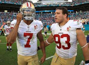 MIAMI GARDENS, FL - NOVEMBER 27:  Colin Kaepernick #7 and Chris Jones #93 of the San Francisco 49ers looks on during a game against the Miami Dolphins on November 27, 2016 in Miami Gardens, Florida.  (Photo by Mike Ehrmann/Getty Images)
