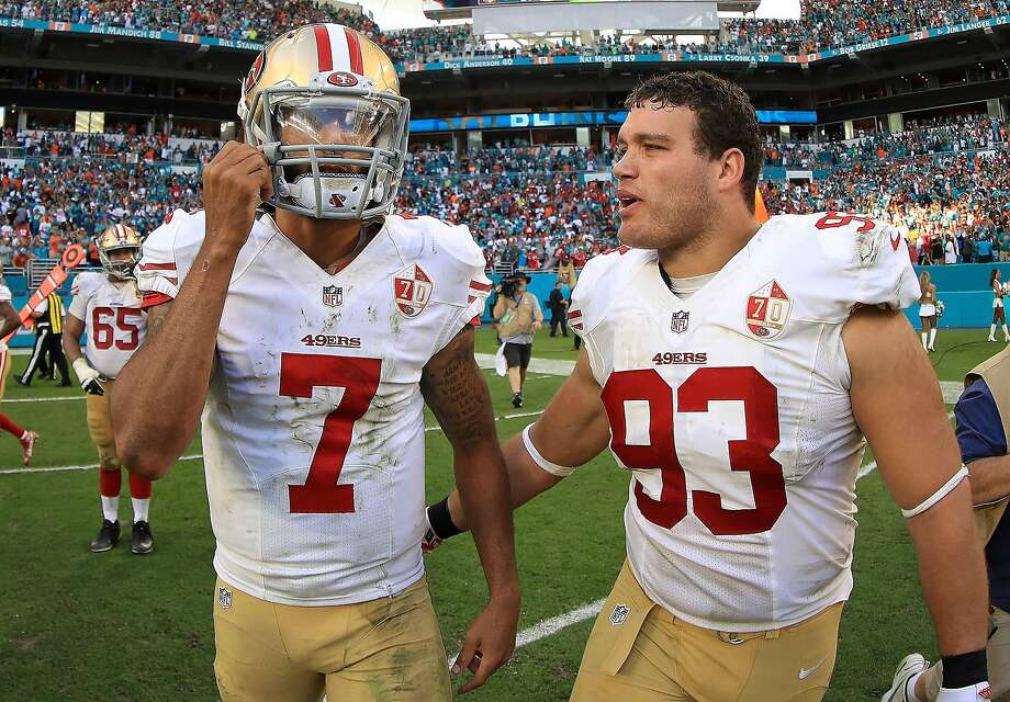 Chris Jones (right) and Colin Kaepernick during the 49ers' 31-24 loss in Miami on Sunday. Photo: Mike Ehrmann, Getty Images