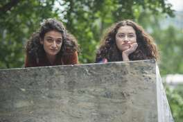 "This image released by the Sundance Institute shows Jenny Slate, left, and Abby Quinn in a scene from, ""Landline"" by Gillian Robespierre. The film is an official selection of the U.S. Dramatic Competition at the 2017 Sundance Film Festival, running from Jan. 19 through Jan. 29. (Jojo Whilden/Sundance Institute via AP)"