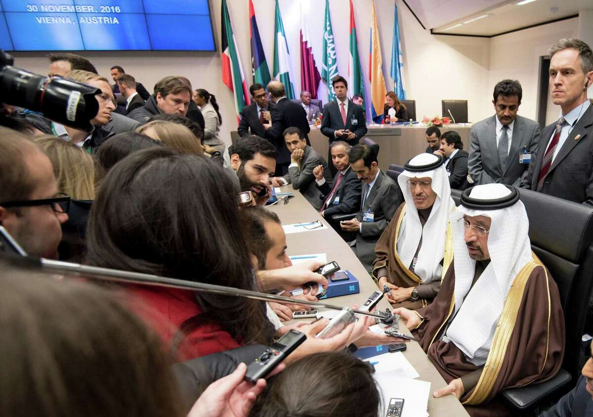 Saudi Arabias energy minister Khalid al-Falih (bottom right) attends a meeting of the Organization of the Petroleum Exporting Countries, OPEC, at the OPEC headquarters in Vienna, Austria on November 30, 2016. OPEC sought to defy expectations and finalise a deal reducing its oil output for the first time in eight years, in an effort to boost painfully low crude prices. / AFP PHOTO / JOE KLAMARJOE KLAMAR/AFP/Getty Images