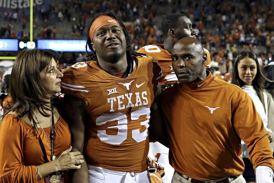 Texas running back D'Onta Forman and coach Charlie Strong walk together after TCU's 31-9 win on Nov. 25, 2016, in Austin. Photo: Joshua Guerra /Associated Press / Joshua Guerra