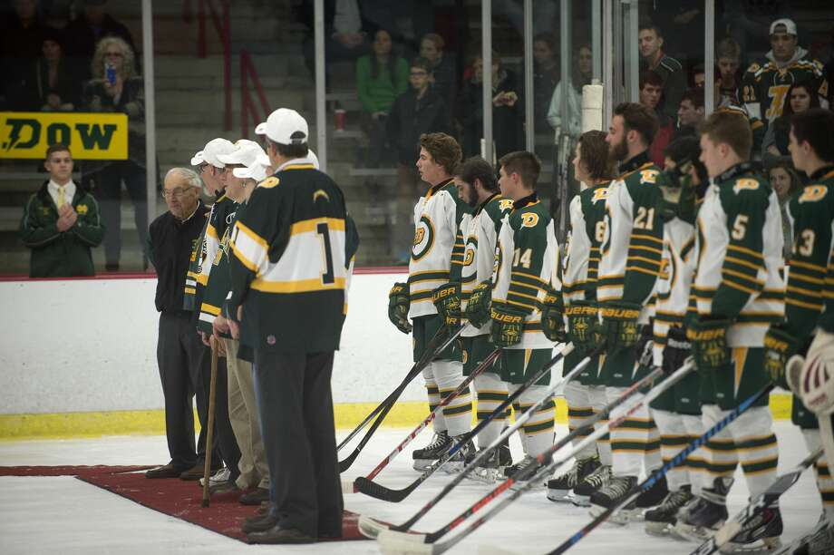 Former Dow High hockey coach Al Quick and members from the 1976 team are honored on the ice before the start of Dow's game against Bay Area Thunder at the Midland Civic Arena Wednesday. Dow commemorated the 40th anniversary of its hockey program. Photo: Brittney Lohmiller/Midland Daily News/Brittney Lohmiller