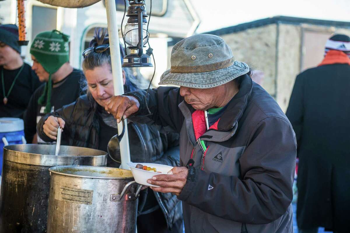 A food line at the Soup Kettle House, one of many ad-hoc kitchens feeding the thousands protesting the Dakota Access pipeline. Soup Kettle House serves up food for a Lakotan palate. , on the Standing Rock Sioux Reservation in Cannon Ball, N.D., Nov. 10, 2016. Feeding the army of protesters has become a political struggle of its own, reflecting the dietary mores of various tribes as well as many vegetarian or vegan non-natives. (Deborah Kates/The New York Times)