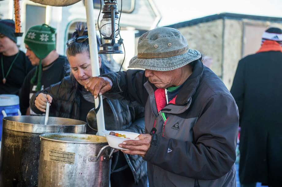 A food line at the Soup Kettle House, one of many ad-hoc kitchens feeding the thousands protesting the Dakota Access pipeline. Soup Kettle House serves up food for a Lakotan palate. , on the Standing Rock Sioux Reservation in Cannon Ball, N.D., Nov. 10, 2016. Feeding the army of protesters has become a political struggle of its own, reflecting the dietary mores of various tribes as well as many vegetarian or vegan non-natives. (Deborah Kates/The New York Times) Photo: DEBORAH KATES, STR / NYTNS