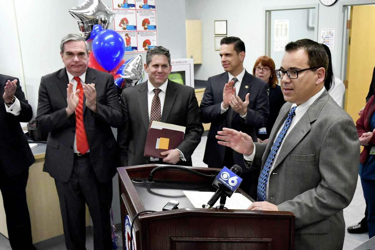 Joe Gambino, CEO of Hometown Health Centers, right, center, announces their partnership with the Schenectady School District during a news conference on Wednesday, Nov. 30, 2016, at Schenectady High in Schenectady, N.Y. (Cindy Schultz / Times Union)
