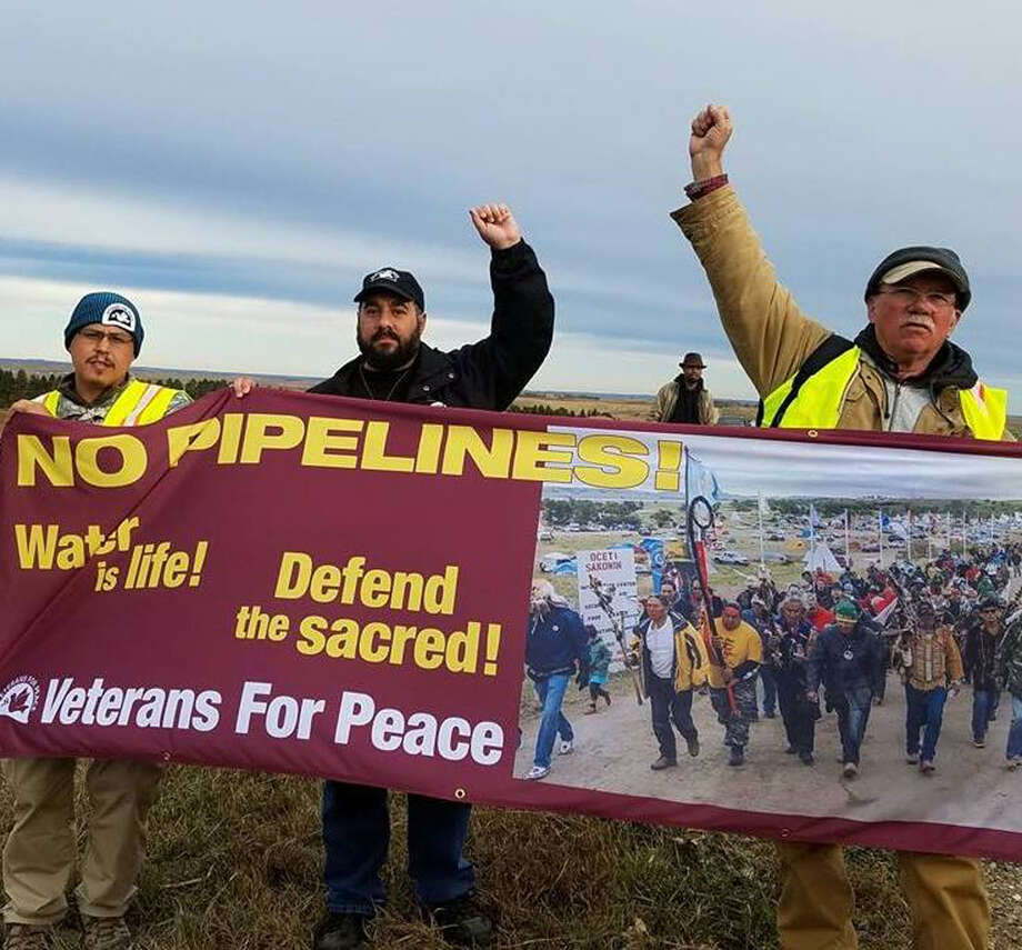 Brian Trautman, 41, of North Greenbush, center, joined fellow demonstrators to take part in protesting against the Dakota Access pipeline in North Dakota. The national board member for Veterans for Peace spent six days acting in solidarity with the Standing Rock Sioux. (Courtesy Brian Trautman)
