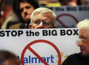Resident Robert DeMayo shows his opposition during a public hearing on a proposed 137,000 square-foot Walmart on Thursday, Nov. 20, 2014, at Ballston Spa High in Ballston Spa, N.Y. (Cindy Schultz / Times Union archive)