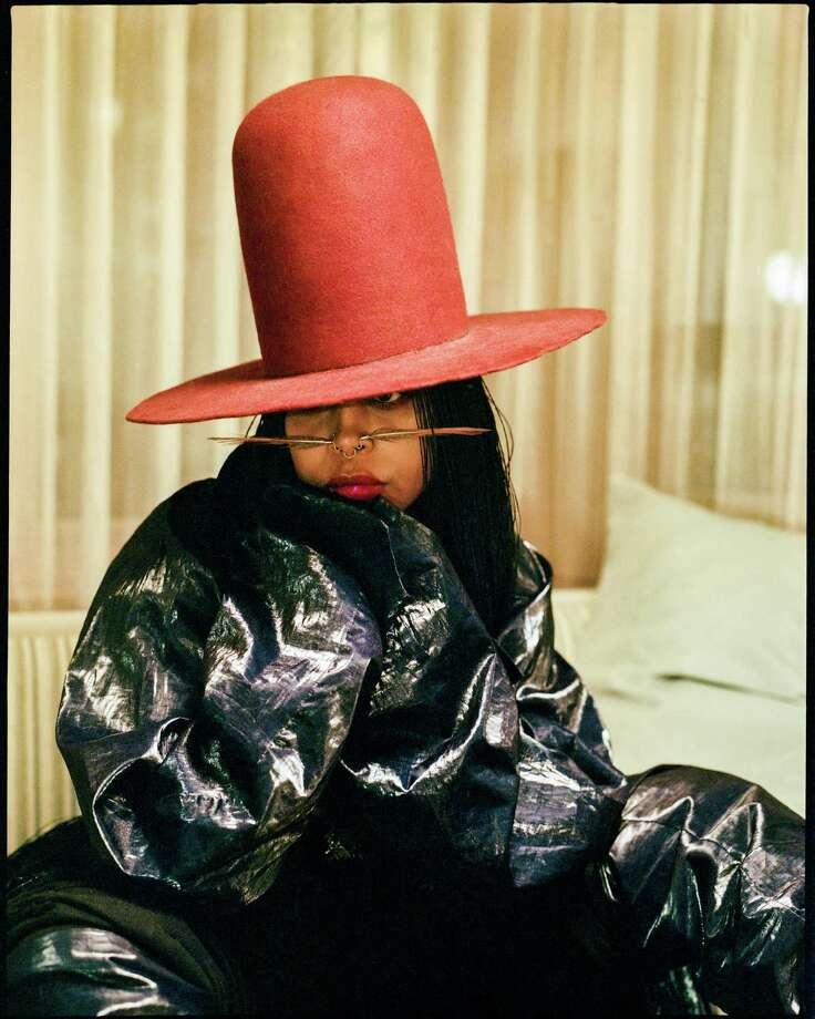 Dallas native and neo soul superstar Erykah Badu wearrs nearly floor-length, micro braids.  Photo: ANDRE D. WAGNER, STR / NYTNS