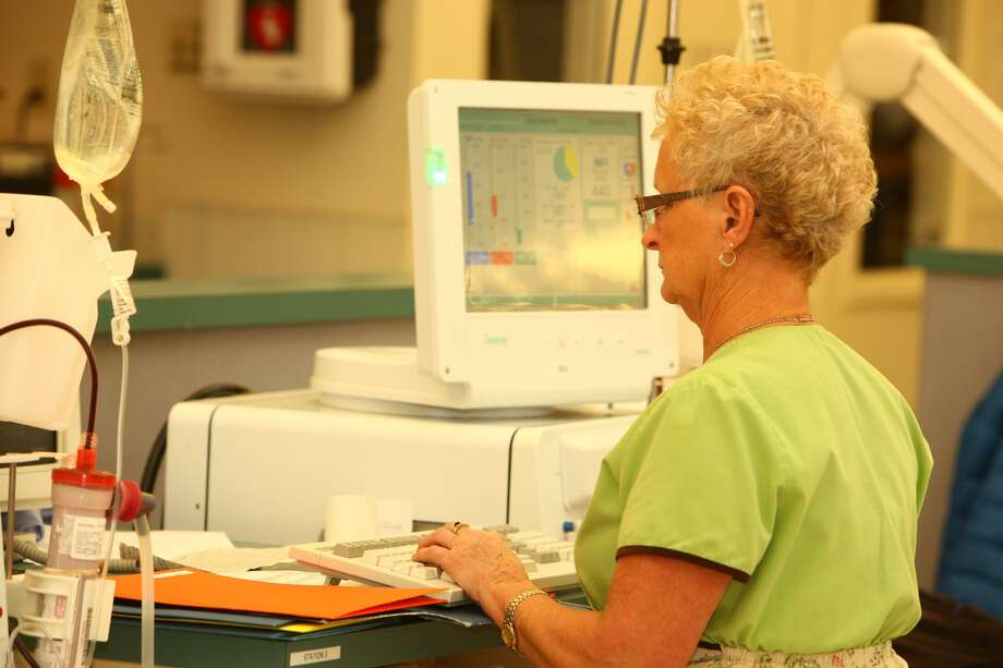 Margaret McHale monitors a dialysis treatment at the Hortense and Louis Rubin Dialysis Center. Money from the sale of the three centers will be gifted to the Community Foundation for the Greater Capital Region. (Hortense and Louis Rubin Dialysis Center)