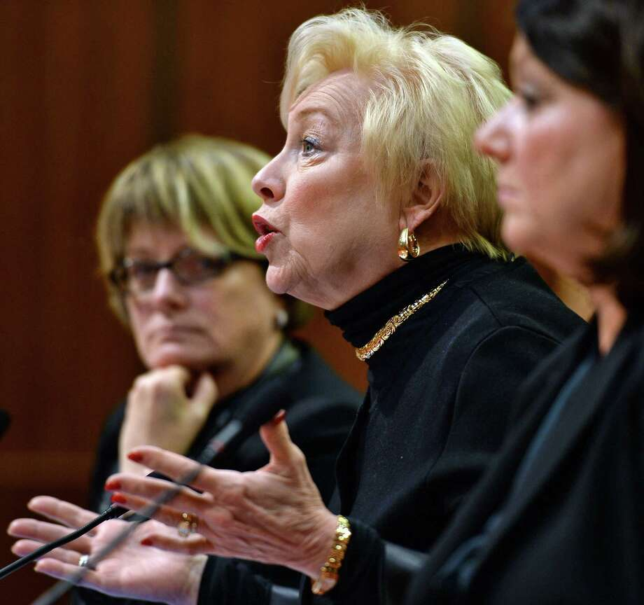 State University of New York Chancellor Nancy L. Zimpher, center, provides testimony as the Assembly holds a hearing on rising costs of higher education and student loan debt at the Legislative Office Building on Wednesday, Nov. 30, 2016, in Albany, N.Y.  (John Carl D'Annibale / Times Union) Photo: John Carl D'Annibale / 20039006A