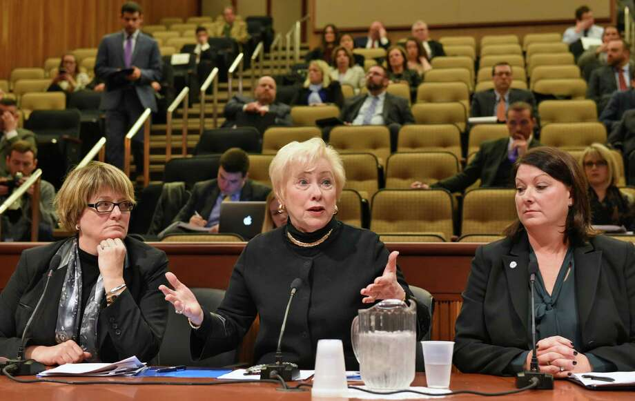 SUNY officials, from left, Eileen McLoughlin, senior vice chancellor for finance and chief financial officer, Chancellor Nancy L. Zimpher and Patricia Thompson, assistant vice chancellor, Student Financial Aid  provide testimony as the Assembly holds a hearing on rising costs of higher education and student loan debt at the Legislative Office Building on Wednesday, Nov. 30, 2016, in Albany, N.Y.  (John Carl D'Annibale / Times Union) Photo: John Carl D'Annibale / 20039006A