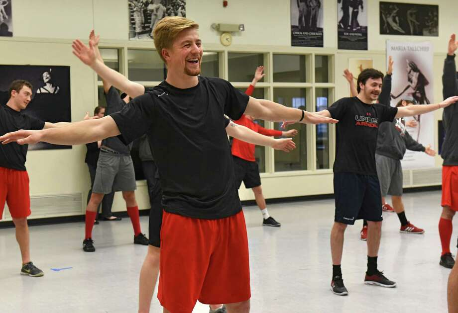 "Ty Loney laughs as the Adirondack Thunder hockey team takes a class taught by an instructor from the School of the Arts at National Museum of Dance on Wednesday, Nov. 30, 2016 in Saratoga Springs, N.Y. The hockey team also toured ""The Dancing Athlete"" exhibit. (Lori Van Buren / Times Union) Photo: Lori Van Buren / 20038975A"