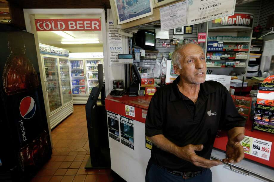 "Mehran ""Ron"" Jadidi, owner of the Shell store, talks Wednesday about telling his employee by phone to call the police after a man stole a beer on Tuesday. Photo: Melissa Phillip, Staff / © 2016 Houston Chronicle"
