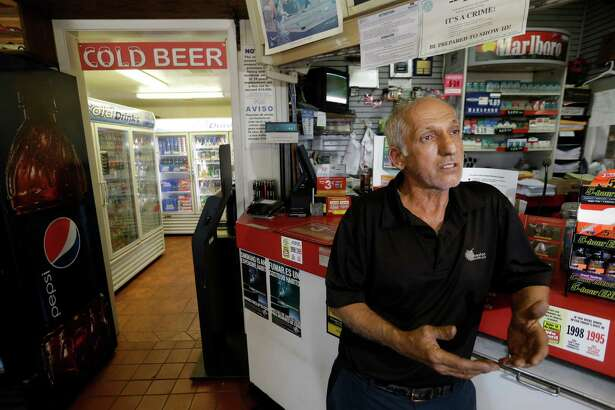 "Mehran ""Ron"" Jadidi, owner of the Shell store, talks Wednesday about telling his employee by phone to call the police after a man stole a beer on Tuesday."
