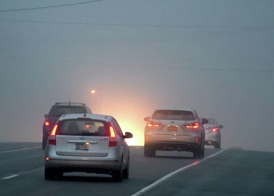Heavy fog slowed drivers on Wednesday morning, Nov. 30, 2016, on Route 9 in Clifton Park, N.Y.   (Skip Dickstein/Times Union) Photo: SKIP DICKSTEIN