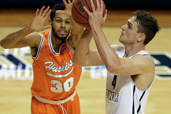Rice guard Egor Koulechov right, shoots past Houston Baptist guard Braxton Bonds left, during the first half of men's college basketball game action at Tudor Fieldhouse Nov. 30, 2016, in Houston.