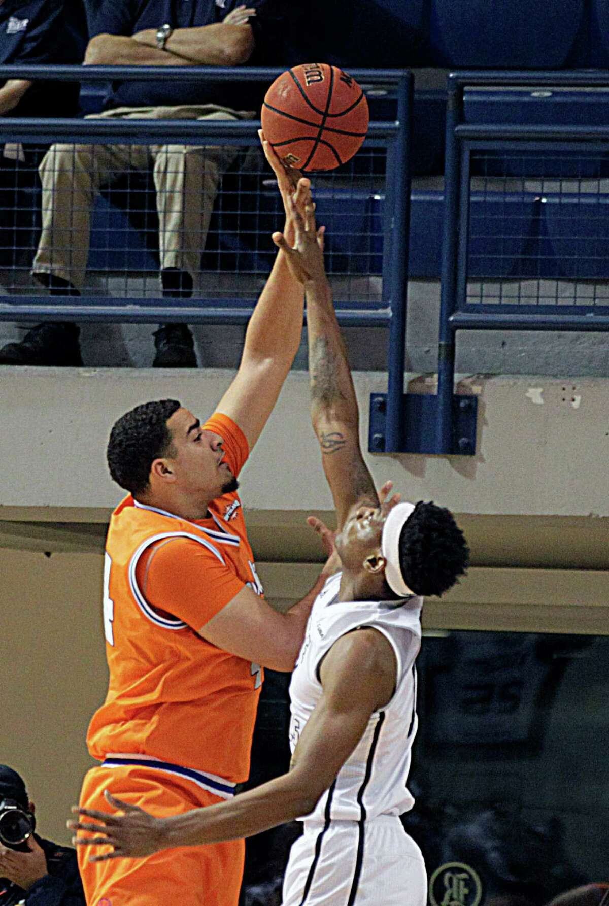 Houston Baptist center Josh Ibarra left, shoots over Rice forward Corey Douglas right, during the first half of men's college basketball game action at Tudor Fieldhouse Nov. 30, 2016, in Houston.
