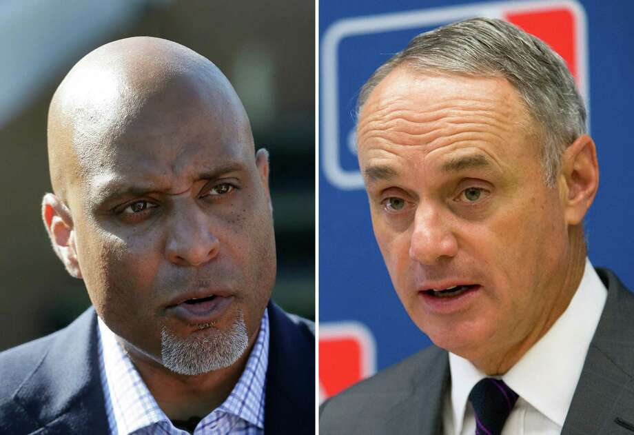 FILE - At left, in a March 17, 2015, file photo, Major League Baseball Players Association executive and former Detroit Tigers first baseman Tony Clark talks to the media before a spring training exhibition baseball game in Lakeland, Fla. At right, in a May 19, 2016, file photo, Baseball Commissioner Rob Manfred speaks to reporters during a news conference at Major League Baseball headquarters in New York. Negotiators for baseball players and owners are meeting this week in Irving, Texas, in an attempt to reach agreement on a collective bargaining agreement to replace the five-year contract that expires Thursday, Dec. 1, 2016. (AP Photo/File) ORG XMIT: NY163 / AP