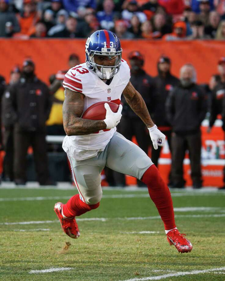 In  this Sunday, Nov. 27, 2016, photo, New York Giants wide receiver Odell Beckham Jr. runs the ball in the second half of an NFL football game against the Cleveland Browns in Cleveland. Beckham wants the ball any way he can get it. If that means the big-play wide receiver adds the job of returning punts for the New York Giants, he's up for it. (AP Photo/Ron Schwane) ORG XMIT: NY186 Photo: Ron Schwane / AP
