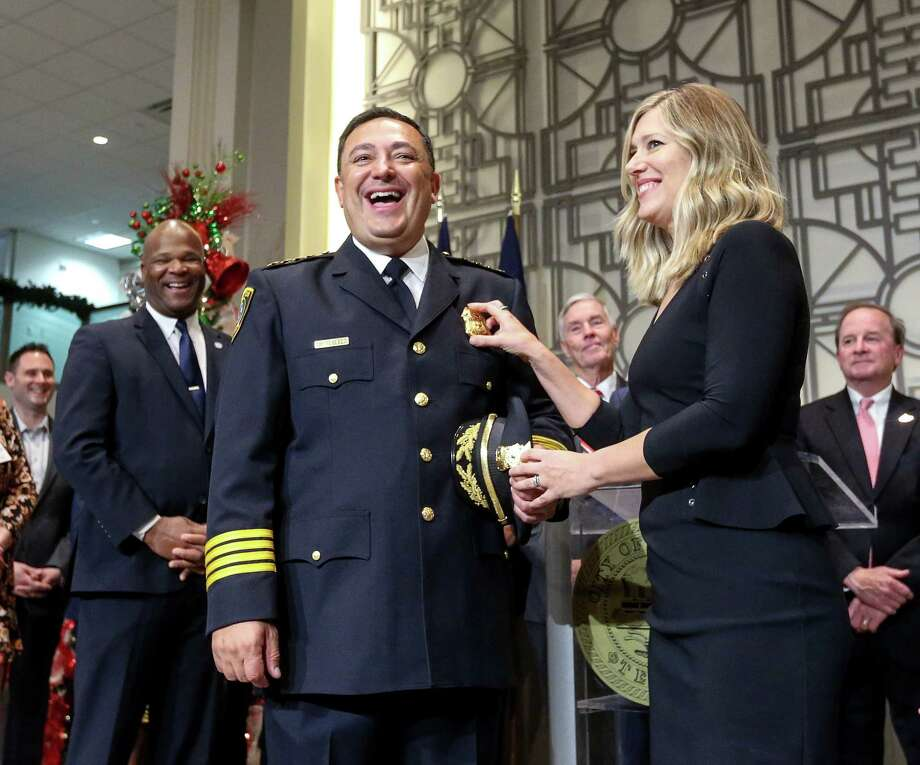 Police Chief Art Acevedo, third from left, jokes with his wife Tanya Acevedo, whom he said stuck him while pinning his badge on, after he was sworn in, Wednesday, Nov. 30, 2016, in Houston. ( Jon Shapley / Houston Chronicle ) Photo: Jon Shapley, Staff / © 2015  Houston Chronicle