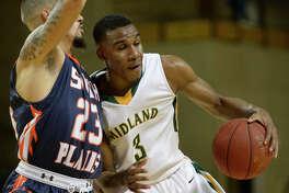 Midland College's Devin Campbell (3) spins around South Plains' Jordan Brangers (23) on Wednesday, Nov. 30, 2016, at Chaparral Center. James Durbin/Reporter-Telegram