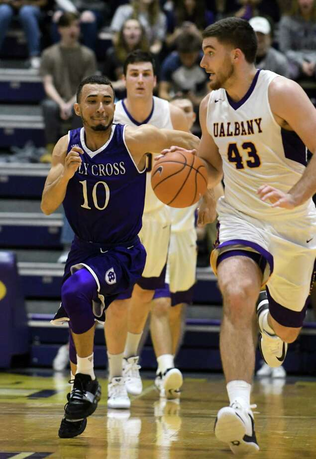 UAlbany's Greig Stire comes away with a steal during their college basketball game against Holy Cross at SEFCU Arena on Wednesday Nov. 30, 2016 in Albany, N.Y.  (Michael P. Farrell/Times Union) Photo: Michael P. Farrell / 20038933A