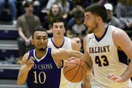 UAlbany's Greig Stire comes away with a steal during their college basketball game against Holy Cross at SEFCU Arena on Wednesday Nov. 30, 2016 in Albany, N.Y.  (Michael P. Farrell/Times Union)