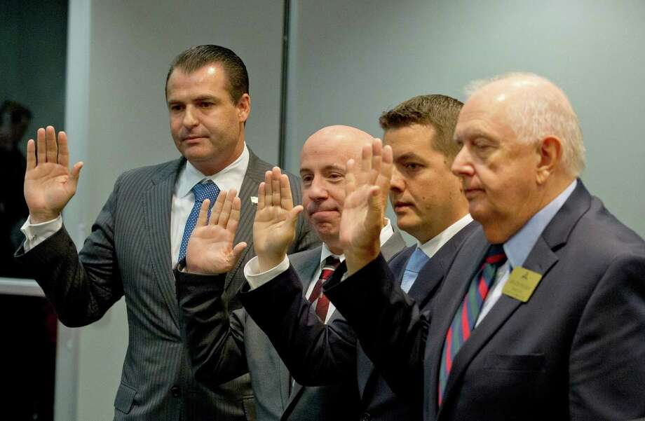 Gordy Bunch, John Anthony Brown, Brian Boniface and Bruce Rieser are sworn into office during The Woodlands Township's board meeting Wednesday in The Woodlands. Photo: Jason Fochtman, Staff Photographer / Houston Chronicle