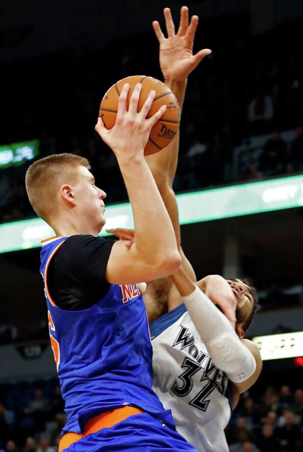 New York Knicks' Kristaps Porzingis, left, of Latvia, gets fouled by Minnesota Timberwolves' Karl-Anthony Towns as he lays up during the second half of an NBA basketball game Wednesday, Nov. 30, 2016, in Minneapolis. The Knicks won 106-104. Porzingis led the Knicks with 29 points while Towns led the Timberwolves with 47. (AP Photo/Jim Mone) ORG XMIT: MNJM109 Photo: Jim Mone / Copyright 2016 The Associated Press. All rights reserved.