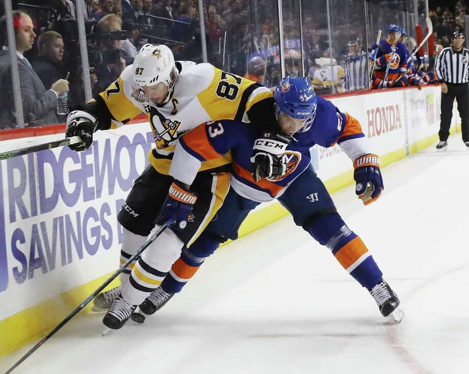 NEW YORK, NY - NOVEMBER 30:  Casey Cizikas #53 of the New York Islanders holds off Sidney Crosby #87 of the Pittsburgh Penguins during the first period at the Barclays Center on November 30, 2016 in the Brooklyn borough of New York City.  (Photo by Bruce Bennett/Getty Images) ORG XMIT: 672870491 Photo: Bruce Bennett / 2016 Getty Images