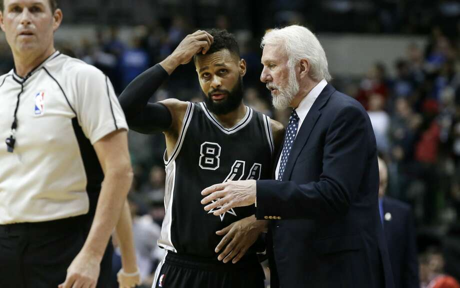 San Antonio Spurs head coach Gregg Popovich, right, talks with guard Patty Mills (8) during the second half of an NBA basketball game against the Dallas Mavericks in Dallas, Wednesday, Nov. 30, 2016. (AP Photo/LM Otero) Photo: LM Otero/Associated Press