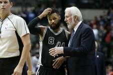 San Antonio Spurs head coach Gregg Popovich, right, talks with guard Patty Mills (8) during the second half of an NBA basketball game against the Dallas Mavericks in Dallas, Wednesday, Nov. 30, 2016. (AP Photo/LM Otero)
