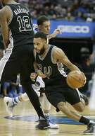 San Antonio Spurs guard Patty Mills (8) uses a screen by teammate LaMarcus Aldridge (12) to beat Dallas Mavericks defender Seth Curry during the second half of an NBA basketball game in Dallas, Wednesday, Nov. 30, 2016. The Spurs won 94-87. (AP Photo/LM Otero)