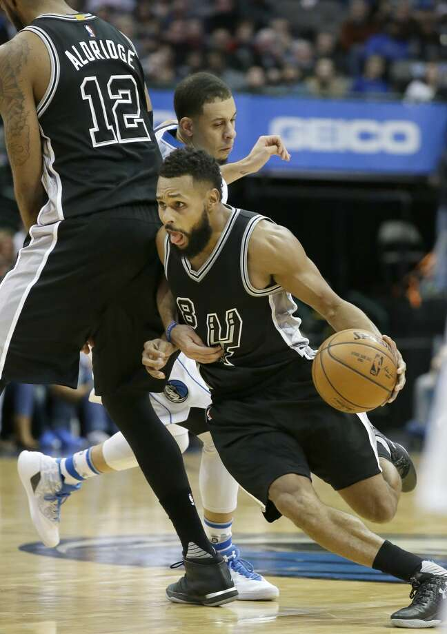 San Antonio Spurs guard Patty Mills (8) uses a screen by teammate LaMarcus Aldridge (12) to beat Dallas Mavericks defender Seth Curry during the second half of an NBA basketball game in Dallas, Wednesday, Nov. 30, 2016. The Spurs won 94-87. (AP Photo/LM Otero) Photo: LM Otero/Associated Press