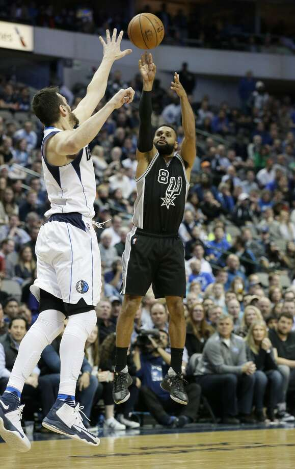 San Antonio Spurs guard Patty Mills (8) shoots a three pointer against Dallas Mavericks center Andrew Bogut (6) during the second half of an NBA basketball game in Dallas, Wednesday, Nov. 30, 2016. The Spurs won 94-87. (AP Photo/LM Otero) Photo: LM Otero/Associated Press