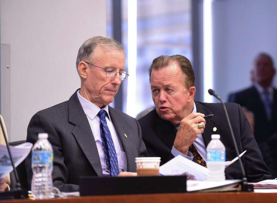 City councilmen Mike Gallagher, left, and Joe Krier have a discussion during a session B meeting on the status of city improvement bonds on Wednesday, Aug. 10, 2016. Photo: Billy Calzada, Staff / San Antonio Express-News / San Antonio Express-News