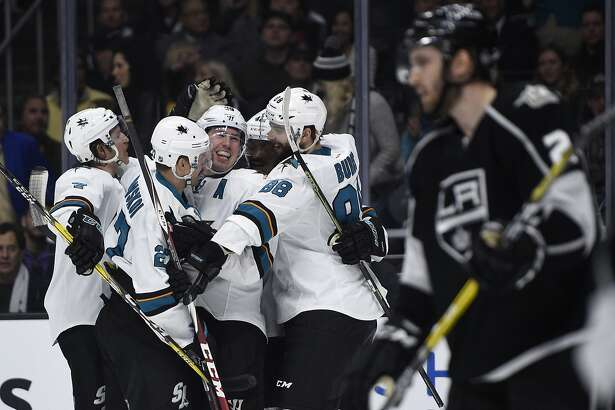 San Jose Sharks center Logan Couture, center, celebrates his goal with teammates during the first period of an NHL hockey game against the Los Angeles Kings in Los Angeles, Wednesday, Nov. 30, 2016. (AP Photo/Kelvin Kuo)