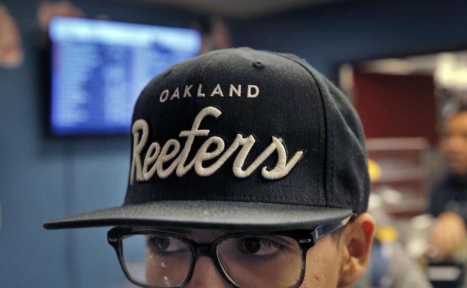 Jason Herrera wears his Oakland Reefers had while working at Magnolia Wellness, a medical marijuana dispensary in Oakland, Calif., on Wednesday, November 30, 2016. Like many businesses working in the cannabis industry, Magnolia Wellness has to deal with a lack of access to formal banking services. However, a special bank may soon open up in oakland to fill this void. Photo: Carlos Avila Gonzalez, The Chronicle
