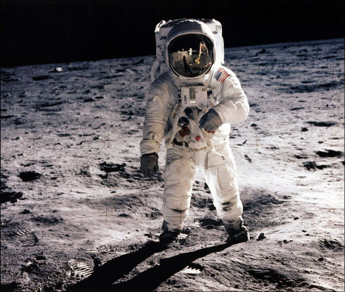 (FILES) This July 20, 1969 file photo shows astronaut Edwin E. Aldrin Jr. walking on the surface of the moon near the leg of the Lunar Module (ML)