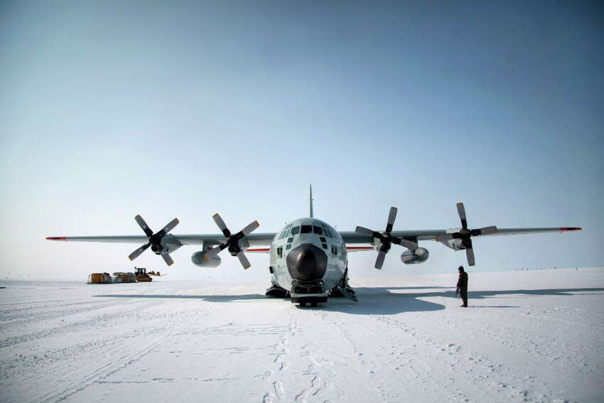 An LC-130 plane, equipped with skies, from the Air National Guard's 109th Airlift Wing at Summit Station, a remote outpost in Greenland, July 15, 2015. Summit Station is one of several Greenland sites where researchers gather data that will improve climate models and help predict climate change affecting future generations. (Josh Haner/The New York Times) ORG XMIT: XNYT49
