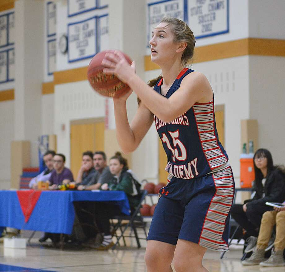 Greens Farms Academy guard Lexi Kimball fires up a shot during a game last season. Kimball, a senior, leads the Dragons into the new season beginning Friday. Photo: Contributed Photo /
