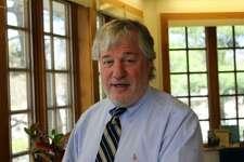 Superintendent of Schools Dr. Dan Brenner in his Leroy Avenue office in Darien.