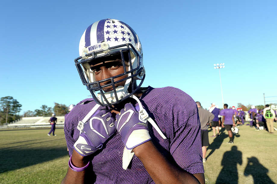 """Newton senior defensive player Deviun Kenebrew says head football coach W. T. Johnston and his teammates have changed his life and helped him get through a difficult year. He moved to Newton after his family lost their Jasper home in a fire, and Deviun also lost his mother last year due to a heart problem. He wears bracelets saying """"Brothers in Christ"""" to note the special role the team plays in his lfe. Photo taken Wednesday, November 30, 2016 Kim Brent/The Enterprise Photo: Kim Brent / Beaumont Enterprise"""